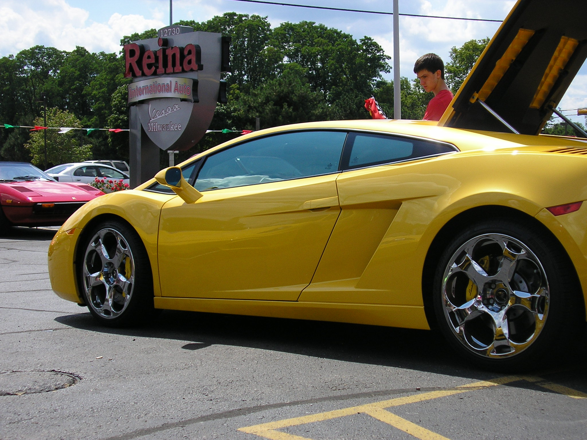 Reina International Auto Exotic Sports Cars And Vespa